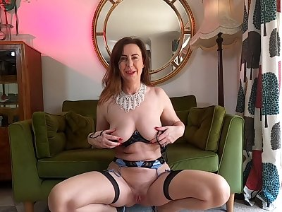 Solo adult Lara in unmentionables and stockings loves teasing someone's skin camera