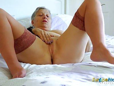Big tits granny chick masturbates in stockings