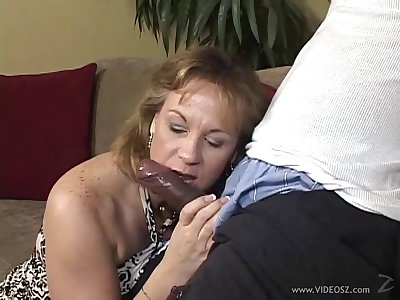Beamy breasted blonde milf eating a BBC in her living room