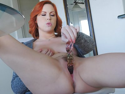 Hot redhead slides her bend the elbow toy deep down the pussy