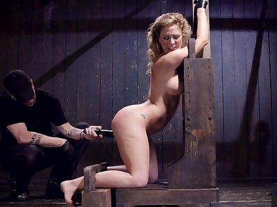 Busty MILF shackled in inverted bondage
