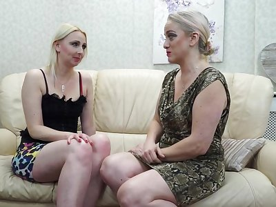 Two adult lesbians are coition on the couch and grousing from pleasure to the fullest extent a finally cumming