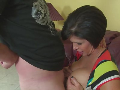 Stacked mature dame Shay Xantippe titty fucks and gives one hell be expeditious for a handjob