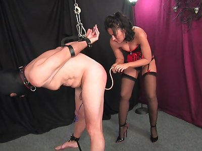 Dominant woman ass fucks her slave and lets him cum on her