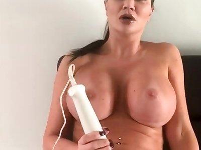 XXX busty brunette toys her wet twat