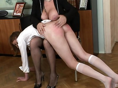 Naughty mistress Madam spanks there ass of lackey girl Lolly Gyrate